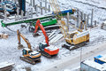 Special construction machinery on the construction site in winter season Royalty Free Stock Photos