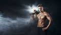 Special force man with the assault rifle gun on dark background smoke Stock Photography