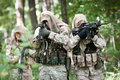 Special forces soldiers on patrol Stock Images