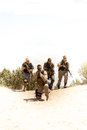 Special forces tactical team a military runs a formation in a desert operation Royalty Free Stock Photos