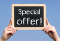 Special offer sign hands of a woman holding a on a blackboard or chalkboard Stock Image