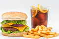 Special snack studio photography of a hamburger with fries and a coke Stock Images