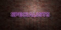SPECIALISTS - fluorescent Neon tube Sign on brickwork - Front view - 3D rendered royalty free stock picture Royalty Free Stock Photo