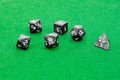 Specialized polyhedral dice for role-playing games on green clot Royalty Free Stock Photo