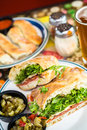 Specialty sub fresh sandwich with melted mozzarella cheese in italian restaurant Stock Photography