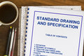 Specification drawing and standards plans with coffee and blueprints Stock Image