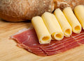 Speck cheese and bread on a wooden table Royalty Free Stock Photography