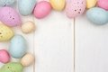Speckled Easter egg corner border against white wood Royalty Free Stock Photo
