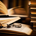 Spectacles on books Stock Images
