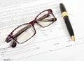 Spectacles and pen Stock Image