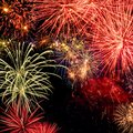 Spectacular fireworks colorful display on black night sky in square format Royalty Free Stock Photos