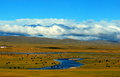 Spectacular landscape in tibetan plateau in sichuan province southwest china countless yarks and vast meadow and rugged Stock Photos