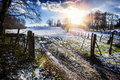 Spectacular sunset over snow covered agricultural field Royalty Free Stock Photo