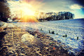Spectacular sunset over snow covered field. Nature background Royalty Free Stock Photo