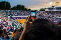 Spectator filming the qf of bucharest open wta july th tennis match between simona halep and lara arruabarrena Royalty Free Stock Image