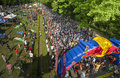 Spectator vs crowded athletes ready to start in a mountainbike contest Royalty Free Stock Photo