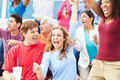 Spectators Celebrating At Outdoor Sports Event Royalty Free Stock Photo