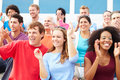Spectators cheering at outdoor sports event smiling Royalty Free Stock Photography