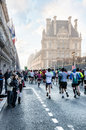 Spectators and participants of the annual paris marathon on the april th run rue de rivoli near louvre welcome them april Stock Photos