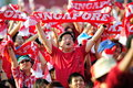 Spectators waving Singapore scarves during NDP 201 Stock Images