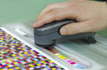 Spectrophotometer color management tool verify patches on test arch press shop prepress department Stock Images