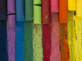 Spectrum of artistic crayons in the lines top view Stock Image