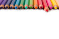 Spectrum of color pencils with the focus on red pencil Stock Image