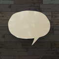 Speech bubble on wooden texture background. Royalty Free Stock Images