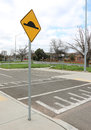Speed bump on asphalt road with yellow and black sign Royalty Free Stock Photo