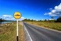 Speed bump sign beside asphalt road Royalty Free Stock Photo