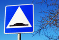 Speed bump sign in blue sky Royalty Free Stock Images