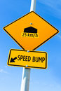 Speed bump sign with speed recommendation Royalty Free Stock Photo