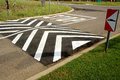 Speed bump at stop street close to a four way intersection Royalty Free Stock Photo