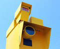 Speed camera seen face on a against a blue sky with clouds Stock Images