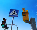 Speed camera and traffic light on green against a blue sky Royalty Free Stock Photography
