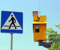 Speed camera and traffic light on green against a blue sky Stock Image