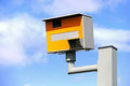 Speed camera uk static or safety against a blue sky Royalty Free Stock Photos