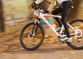 Speed cyclist racer warm autumn outdoor scene Royalty Free Stock Photography