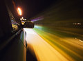 Speed driving car at night motion blur visible Stock Photo