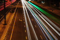 Speed of light high and blurred bus trails in downtown nightscape Stock Image
