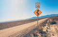 Speed Limit Sign and Curve Sign in desert Royalty Free Stock Photo
