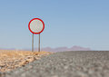 Speed limit sign at a desert road Royalty Free Stock Photo