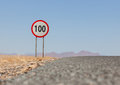 Speed limit sign at a desert road in Namibia Royalty Free Stock Photo