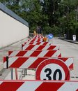 Speed limit sign and hurdles in the road excavation for laying of optical fibre Royalty Free Stock Photography