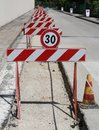 Speed limit sign and hurdles in the road excavation many Stock Photography
