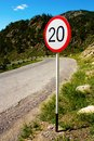 Speed Limit Sign on Old Road in Mountains Stock Photos