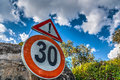 Speed limit sign under a cloudy sky Royalty Free Stock Photo