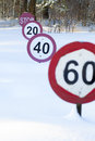 Speed limit signs under the snow Stock Photo