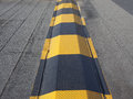 Speed ramp hump in black and yellow steel Stock Image