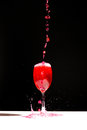 Speed testing pouring red water in a wine glass in isolated Royalty Free Stock Photo